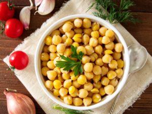 Cooked Chickpeas on bowl on dark wooden table. Healthy, vegetari