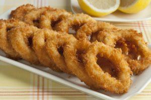 Deep fried squid rings in breadcrumbs