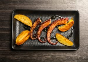 octopus tentacles grilled with potatoes