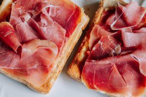 Toasts with serrano ham, traditional spanish breakfast